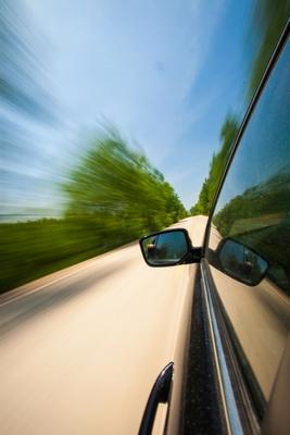auto speeding down road